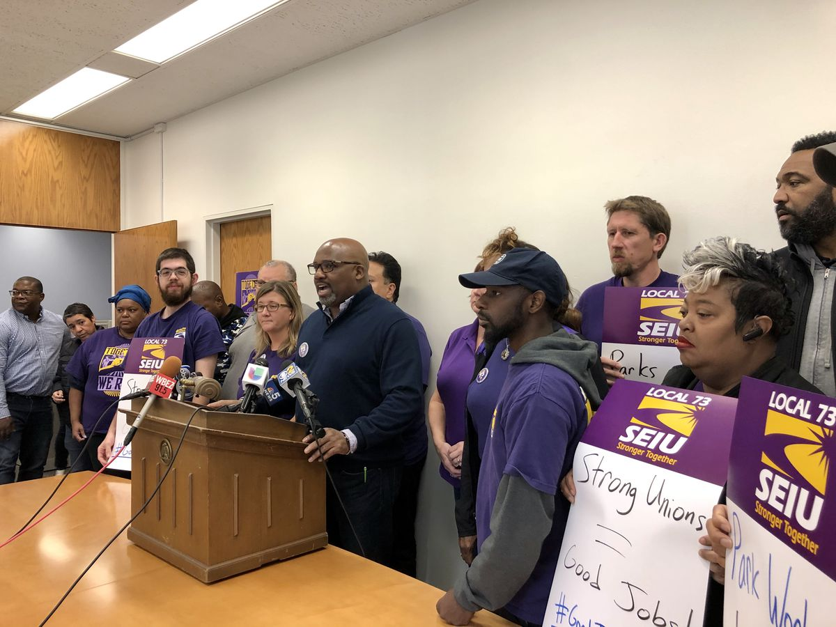 Jeffrey Howard, executive vice president of SEIU 73, announces an agreement between the Chicago Park District and more than 2,500 parks employees.