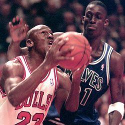 Matt Kryger/Coley News Service Michael Jordan drives on Minnesota's rookie Kevin Garnett during the second quarter of Tuesday night game at the United Center.
