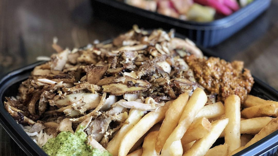 Shredded meat and fries with green sauce