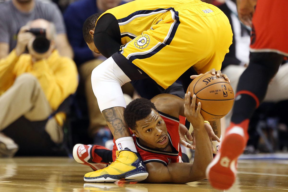 Kyle Lowry looks for a teammate
