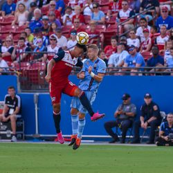 Brandon Servania (18) and New York City FC  defender Anton Tinnerholm (3) hit heads in the first half of the MLS match. Both players returned to the match but were subbed before the half.