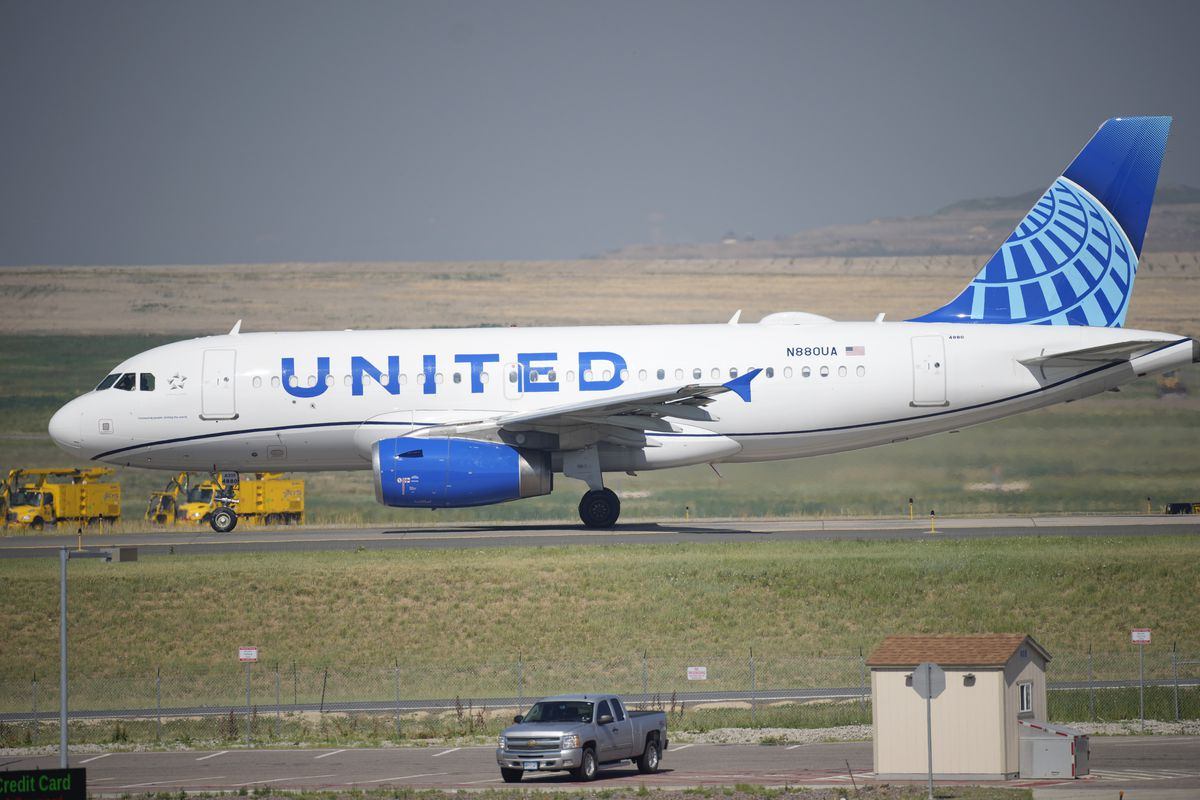 A United Airlines jetliner taxis down a runway in Denver.