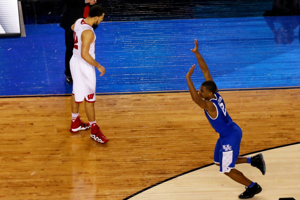 Aaron Harrison celebrates as Kentucky escapes Wisconsin, 74-73, in the Final Four.