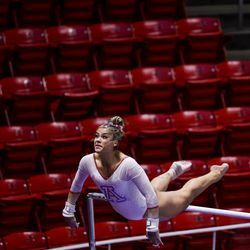 Arizona's Sierra Linton competes on the bars during a meet against Utah at the Huntsman Center in Salt Lake City on Saturday, Jan. 23, 2021.