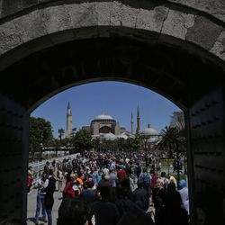 In this Sunday, May 10, 2015 file photo, visitors walk towards the Byzantine-era Hagia Sophia, an UNESCO World Heritage site and one of Istanbul's main tourist attractions in the historic Sultanahmet district of Istanbul. Turkey's Council of State, the country's highest administrative court is expected Friday, July 10, 2020, to release a ruling on a petition requesting that a1934 decision that turned the Hagia Sophia into a museum be annulled.
