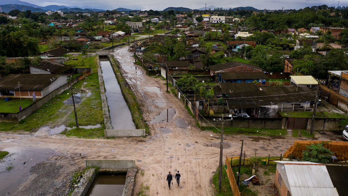 Elders Tanner McKee and Pedro Cabral, missionaries for The Church of Jesus Christ of Latter-day Saints, walk through the Labra neighborhood of Paranaguá, Brazil, on Sunday, June 2, 2019.