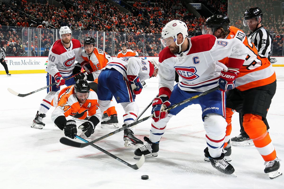 Sean Couturier, Joel Farabee and Jakub Voracek of the Philadelphia Flyers battle for control the puck on a face-off against Shea Weber, Nate Thompson and Joel Armia of the Montreal Canadiens on January 16, 2020 at the Wells Fargo Center in Philadelphia, Pennsylvania.