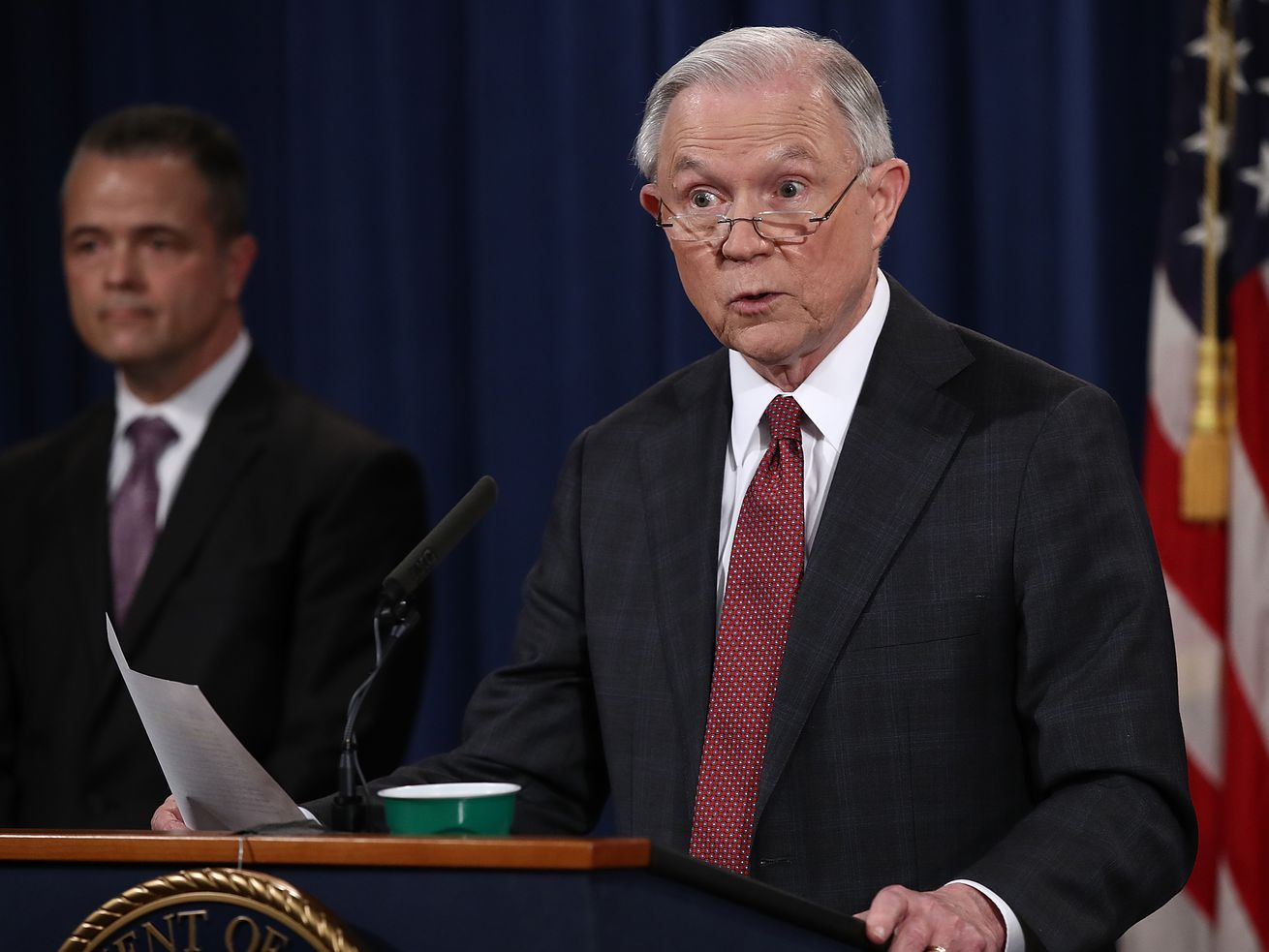 Attorney General Jeff Sessions answers questions during a press conference at the Department of Justice.