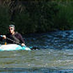 Kayakers John Daniels, left, and Cory Volt float down the Weber River, which winds its way through Morgan County and provides plenty of fishing and picnicking spots and kayaking and tubing opportunities.