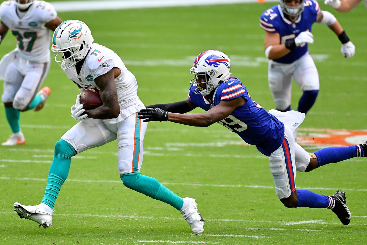 Buffalo Bills cornerback Levi Wallace lunges for Miami Dolphins wide receiver DeVante Parker  during the second half at Hard Rock Stadium