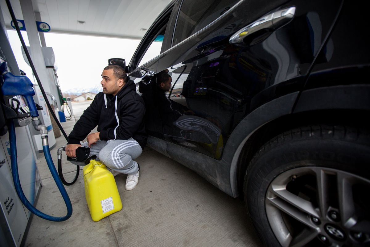 Following a 5.7 magnitude earthquake centered in Magna struck early Wednesday, March 18, 2020, Sunia Sotele, of West Jordan, fills up a gas container at a Chevron in West Valley City after checking in on his family.