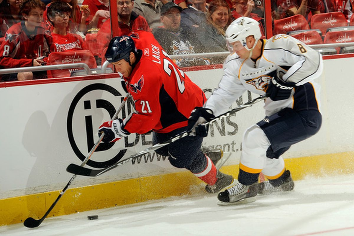 WASHINGTON - OCTOBER 03:  Brooks Laich #21 of the Washington Capitals battles for the puck against Kevin Klein #8 of the Nashville Predators at Verizon Center on October 3 2010 in Washington DC.  (Photo by Greg Fiume/Getty Images)