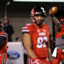 Utah Utes quarterback Tyler Huntley (1) and quarterback Troy Williams (3) warm up before the game against the Colorado Buffaloes at Rice-Eccles Stadium in Salt Lake City on Saturday, Nov. 25, 2017.