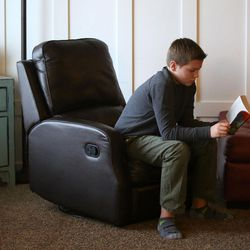 Isaac Widdison reads as his seven siblings play nearby at home in Saratoga Springs, Utah, Friday, Jan. 8, 2016.
