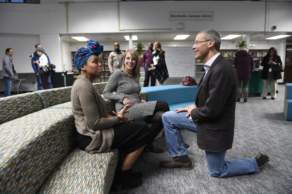 Boasberg chats with teacher librarian Julia Torres, left, and the district's director of library services, Caroline Hughes, middle, in the renovated library on the Montbello campus.