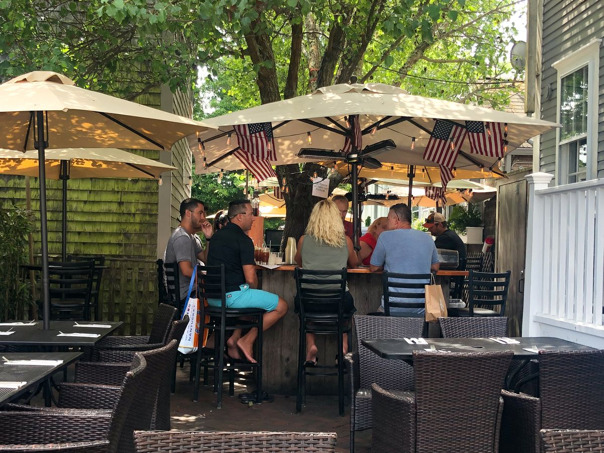 True to its name, Tree Bar is a bar wrapped around a tree. There is additional seating in the area, wooden tables with comfortable wicker chairs.