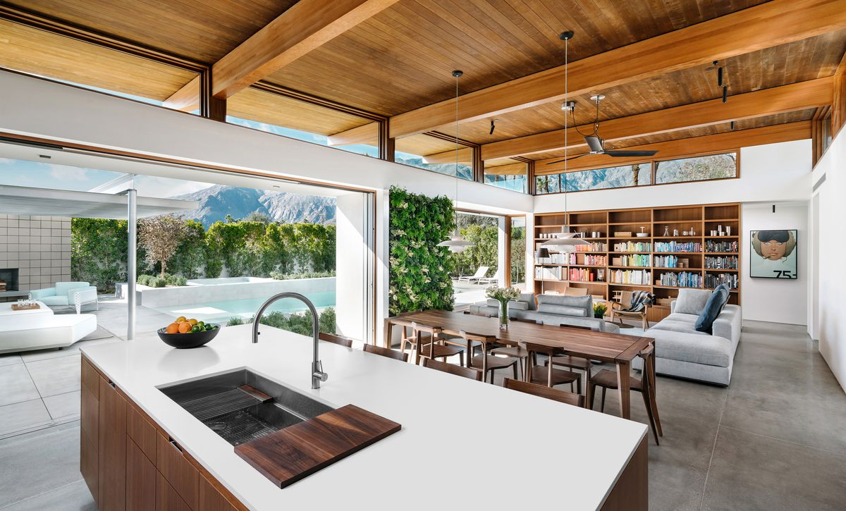 Open plan kitchen next to living room