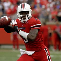 Louisville quarterback Teddy Bridgewater looks to pass against Kentucky during first-half action during an NCAA college football game at Cardinal Stadium in Louisville, Ky., Sunday, Sept. 2, 2012.