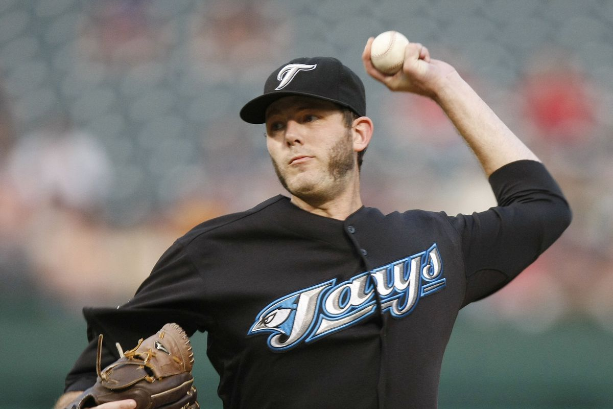 Toronto Blue Jays Brian Tallet delivers a pitch against the