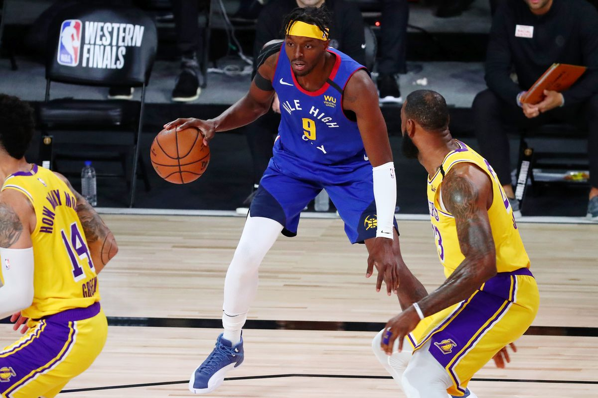 Denver Nuggets forward Jerami Grant (9) dribbles the ball in front of Los Angeles Lakers forward LeBron James (23) during the first quarter in game one of the Western Conference Finals of the 2020 NBA Playoffs at AdventHealth Arena.