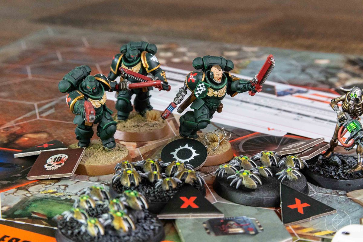 Space Marines attack a swarm of Necron Scarabs.