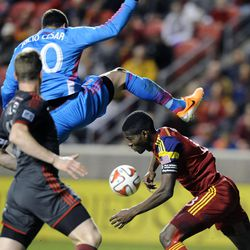 Toronto FC goalkeeper Julio Cesar (30) and Real Salt Lake forward Olmes Garcia (13) collide during a game at Rio Tinto Stadium in Sandy on Saturday, March 29, 2014.