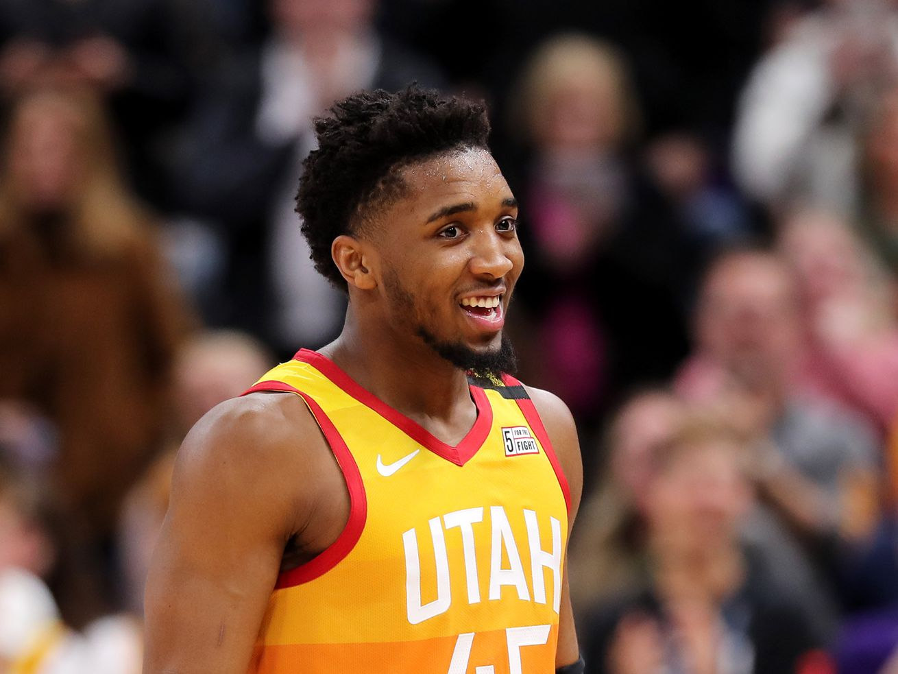 Utah Jazz guard Donovan Mitchell (45) smiles during a timeout as the Utah Jazz and the Miami Heat play in an NBA basketball game at Vivint Smart Home Arena in Salt Lake City on Wednesday, Feb. 12, 2020. Utah won 116-101.