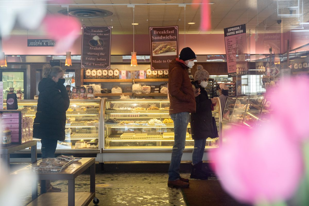 Customers line up inside Dinkel's Bakery Saturday afternoon in the Lake View.