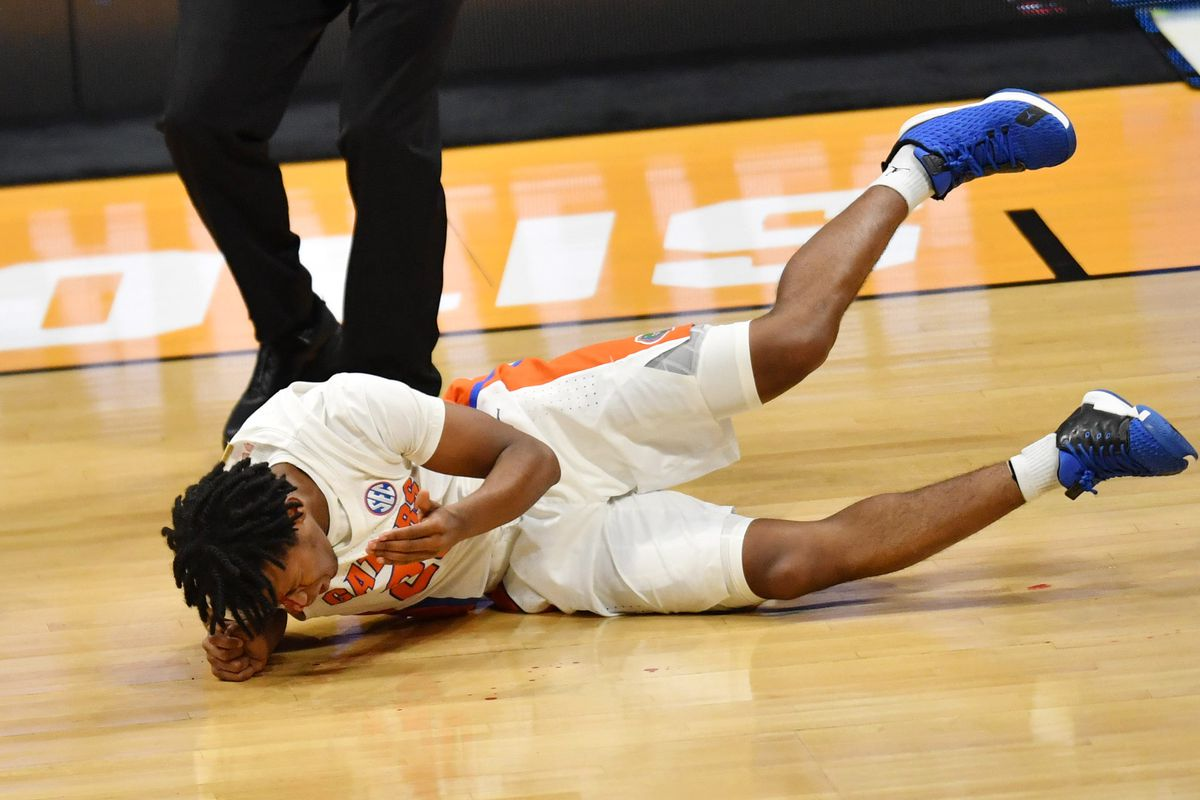 Florida Gators guard Tyree Appleby falls to the floor and sustains an injury against the Virginia Tech Hokies during the first round of the 2021 NCAA Tournament at Hinkle Fieldhouse.