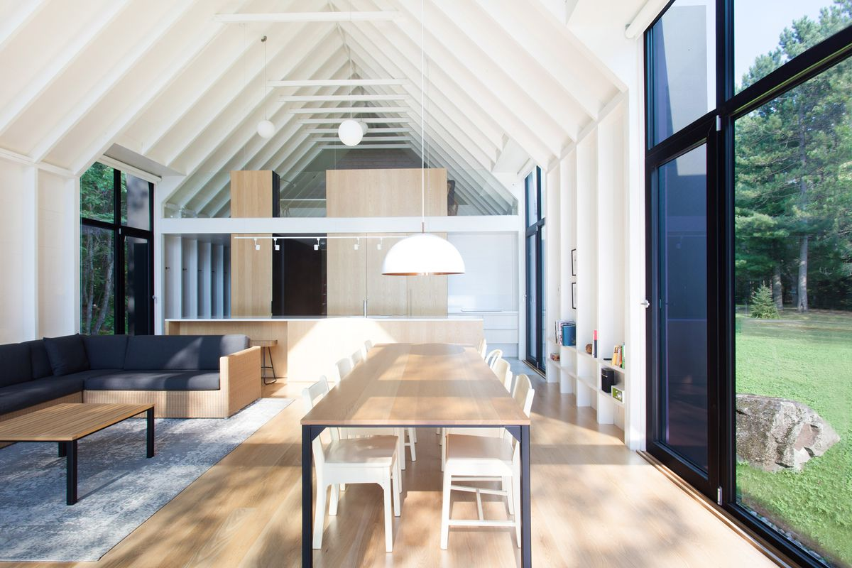 Dining room table in airy, open room