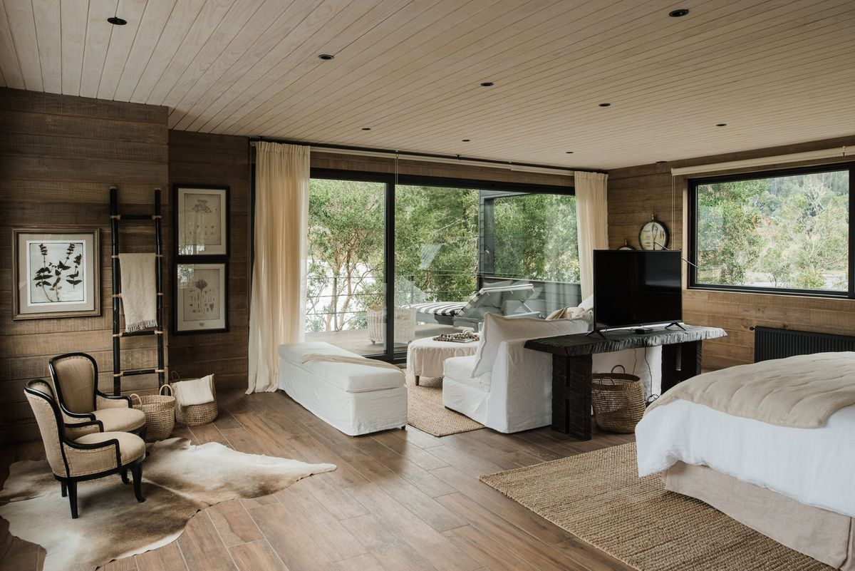 Bedroom clad in wood and neutral colors