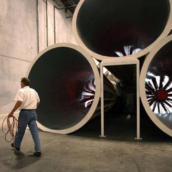 Layne Christensen, founder of Darko Technologies, walks past the fans of his 100-foot-long wind tunnel in Ogden's Business Depot on Thursday, Sept. 26, 2013.