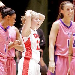 Utah's Rachel Messer, center, reacts after Utah gives up a foul in their 105-96 loss to TCU in quadruple overtime.