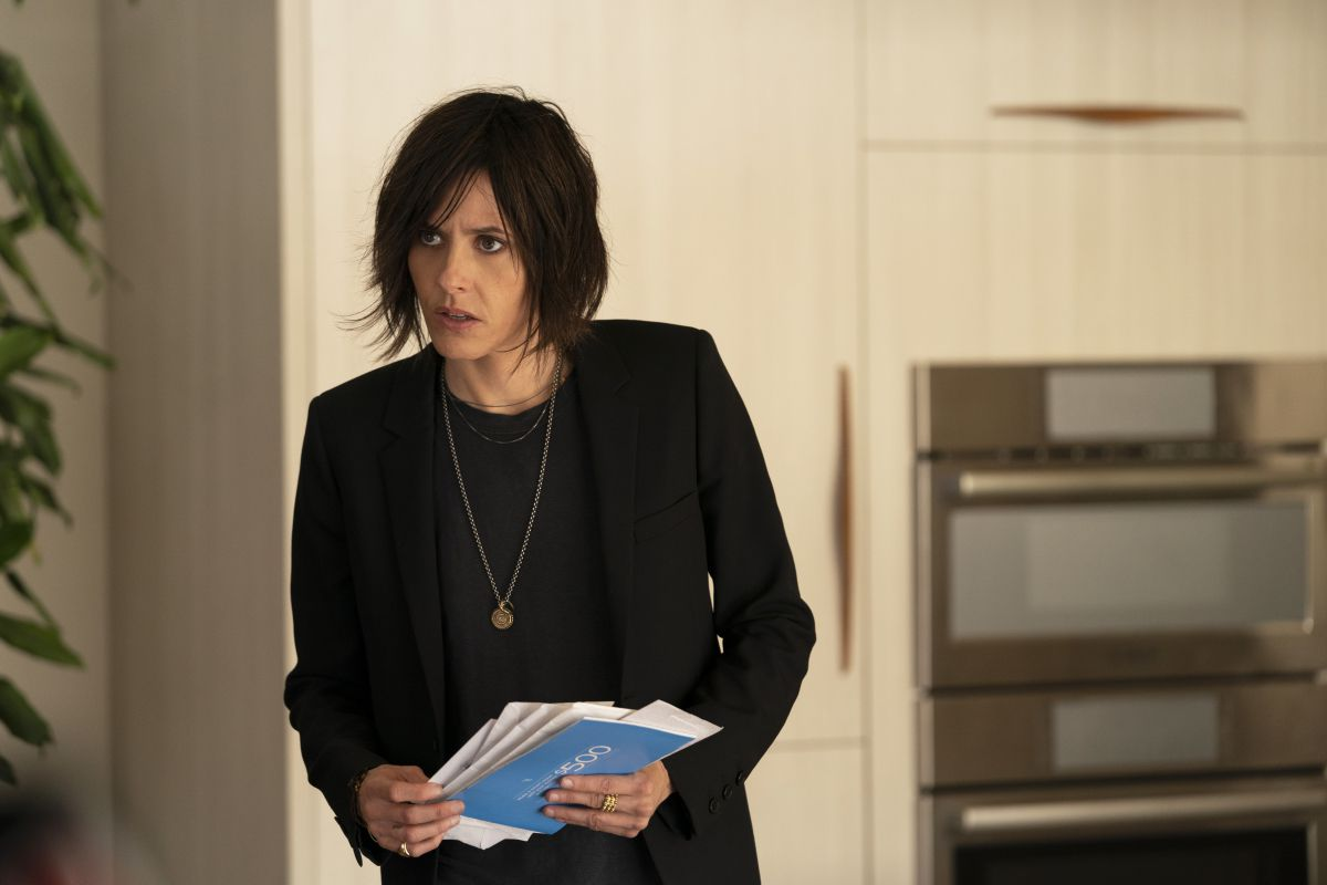 Shane from the L word, holding mail.