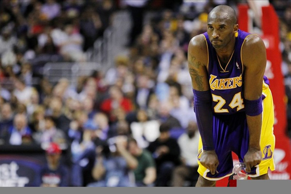 March 7, 2012; Washington, DC, USA; Los Angeles Lakers shooting guard Kobe Bryant (24) watches from the court against the Washington Wizards in the second half at Verizon Center. The Wizards won 106-101. Mandatory Credit: Geoff Burke-US PRESSWIRE