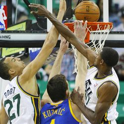 Utah's Rudy Gobert and teammate Jeremy Evans defend a shot by Warriors' Ognjen Kuzmic as they Utah Jazz and the Golden State Warriors play Tuesday, Oct. 8, 2013 in preseason action at Energy Solutions arena in Salt Lake City.