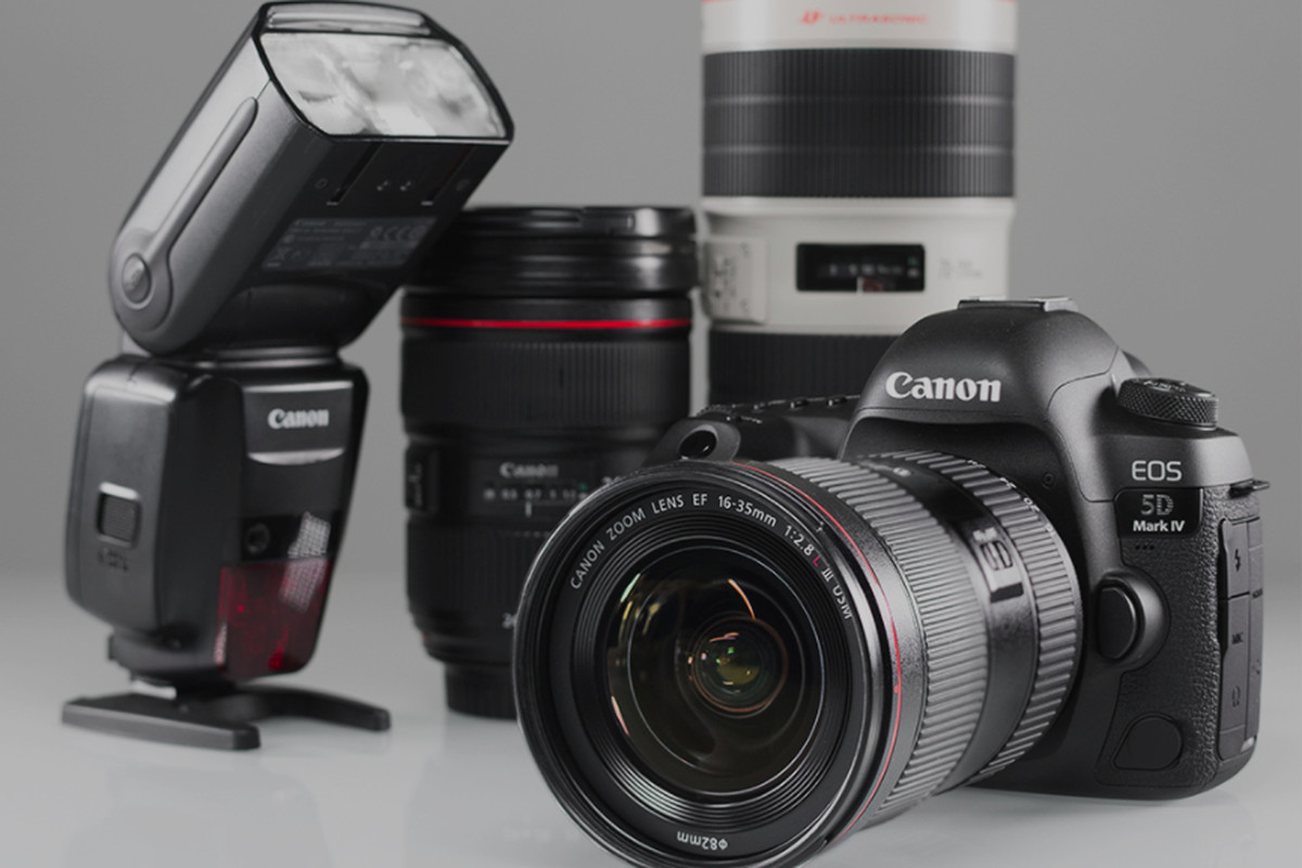 A photograph of a Canon camera and various accessories