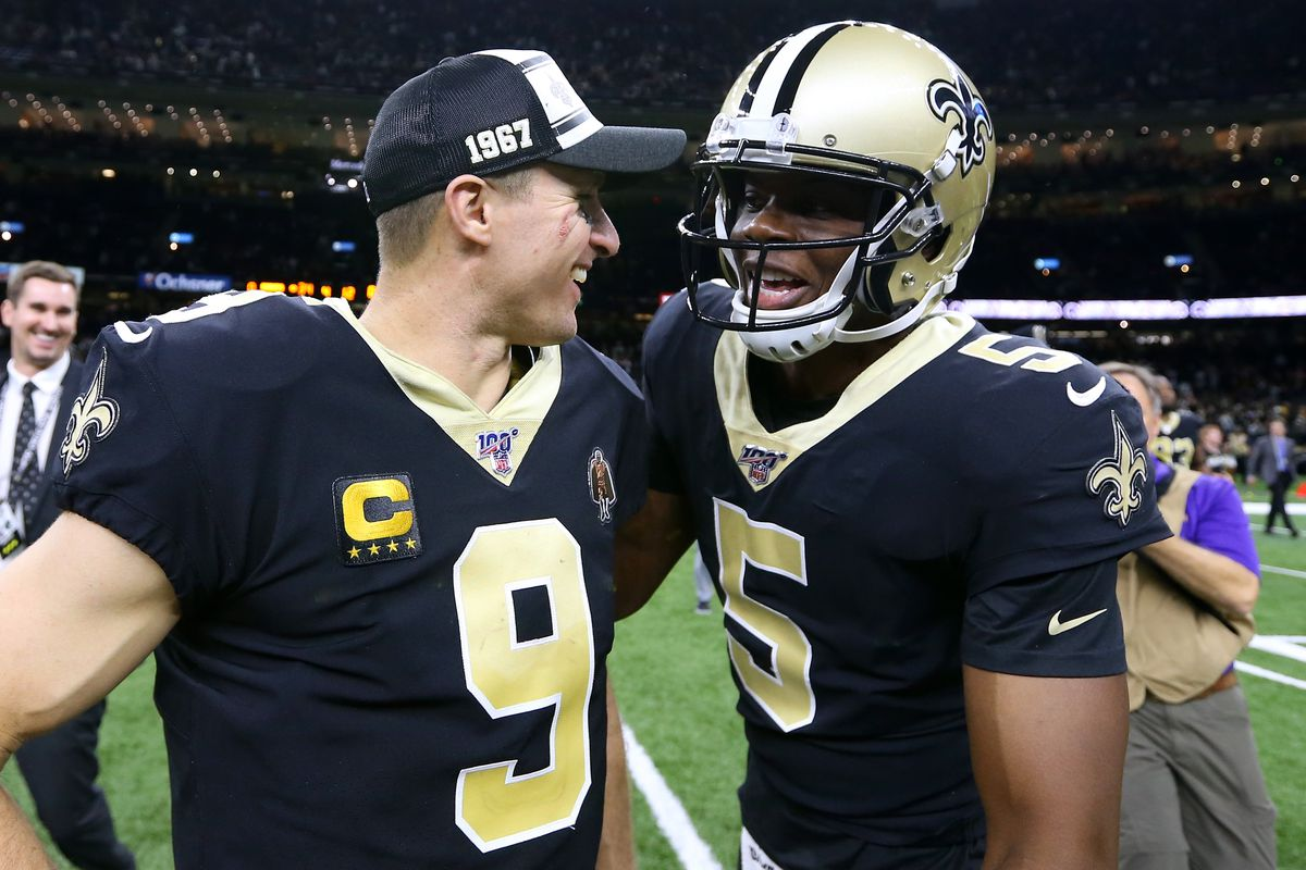 Drew Brees of the New Orleans Saints and Teddy Bridgewater celebrates a win against the Indianapolis Colts at the Mercedes Benz Superdome on December 16, 2019 in New Orleans, Louisiana.