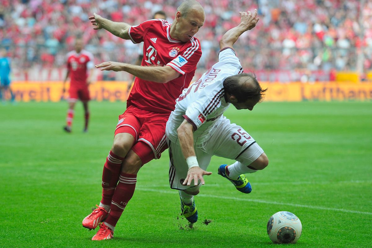 Arjen Robben and Javier Pinola battle for possession in Bayern's (2-0) victory at the Allianz Arena.