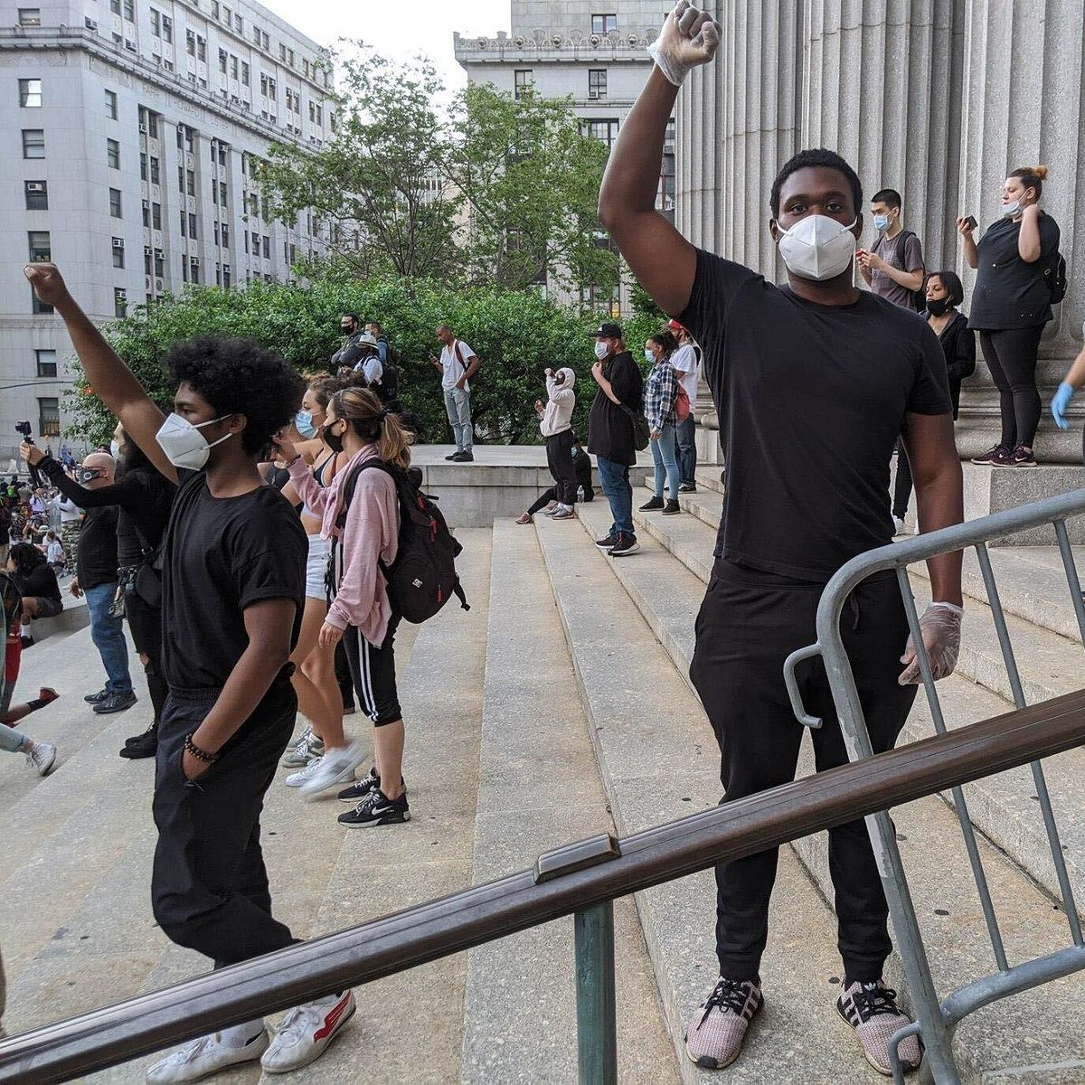 A man wears mask and gloves at police-brutality protest in Manhattan, May 31, 2020.