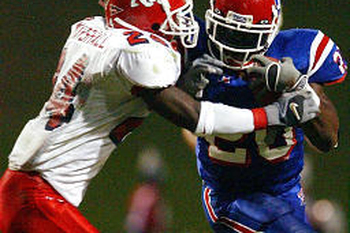 Louisiana Tech running back Ryan Moats (20) tries to fend off Fresno State defensive back Richard Marshall in Fresno's upset loss Saturday.