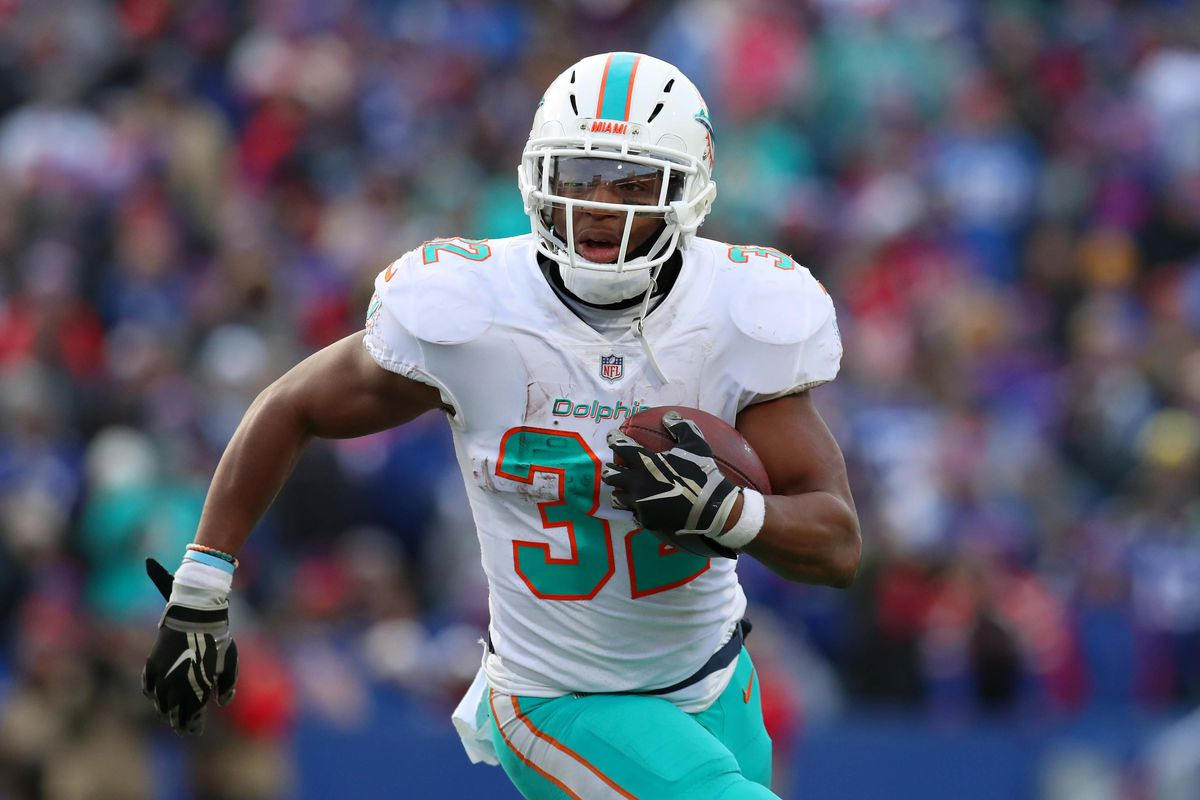 Miami Dolphins running back Kenyan Drake runs with the ball against the Buffalo Bills during the third quarter at New Era Field.