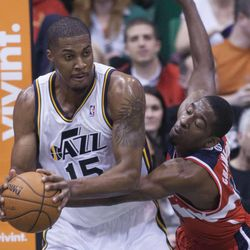 Utah's Derrick Favors grabs onto a defensive rebound with Washington's Jordan Crawford defending as the Jazz and the Wizards play Wednesday, Jan. 23, 2013 at Energy Solutions arena.