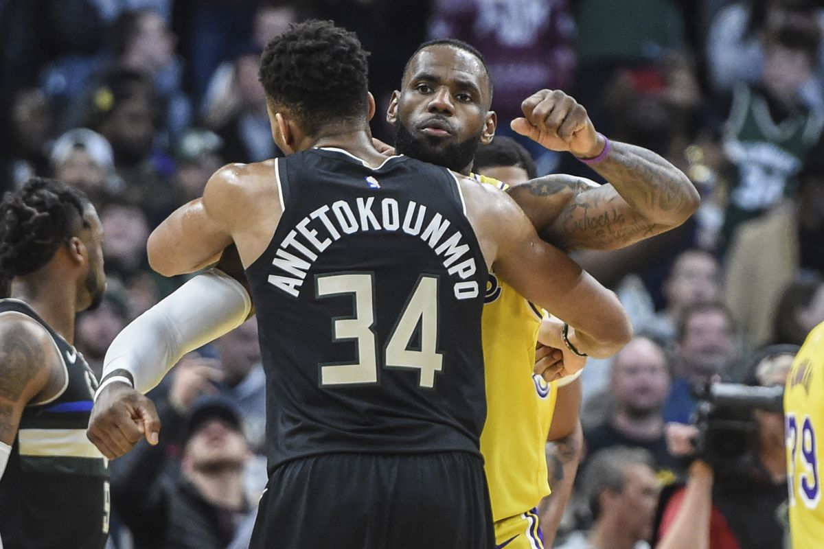 Milwaukee Bucks forward Giannis Antetokounmpo gives Los Angeles Lakers forward LeBron James a hug after a game at Fiserv Forum.