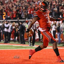 Utah Utes quarterback Troy Williams (3) runs for a touchdown, putting the Utes up 21-0 over the Colorado Buffaloes after the PAT, at Rice-Eccles Stadium in Salt Lake City on Saturday, Nov. 25, 2017.