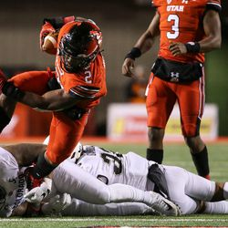 Utah Utes running back Zack Moss (2) runs the ball as Colorado Buffaloes linebacker Rick Gamboa (32) and defensive end George Frazier (5) collide at Rice-Eccles Stadium in Salt Lake City on Saturday, Nov. 25, 2017.