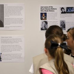 Girl Scouts read about women leaders. | AP Photo