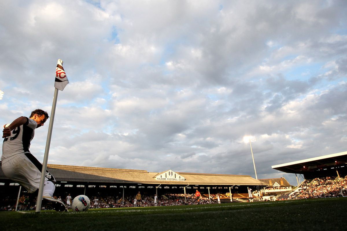 LONDON, ENGLAND - JUNE 30:  Simon Davies of Fulham takes a corner kick during the UEFA Europa League qualifying match between Fulham and NSI Runavik at Craven Cottage on June 30, 2011 in London, England.  (Photo by Warren Little/Getty Images)