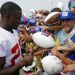 David Wilson signs autographs. [Jim O'Connor-USA TODAY Sports]