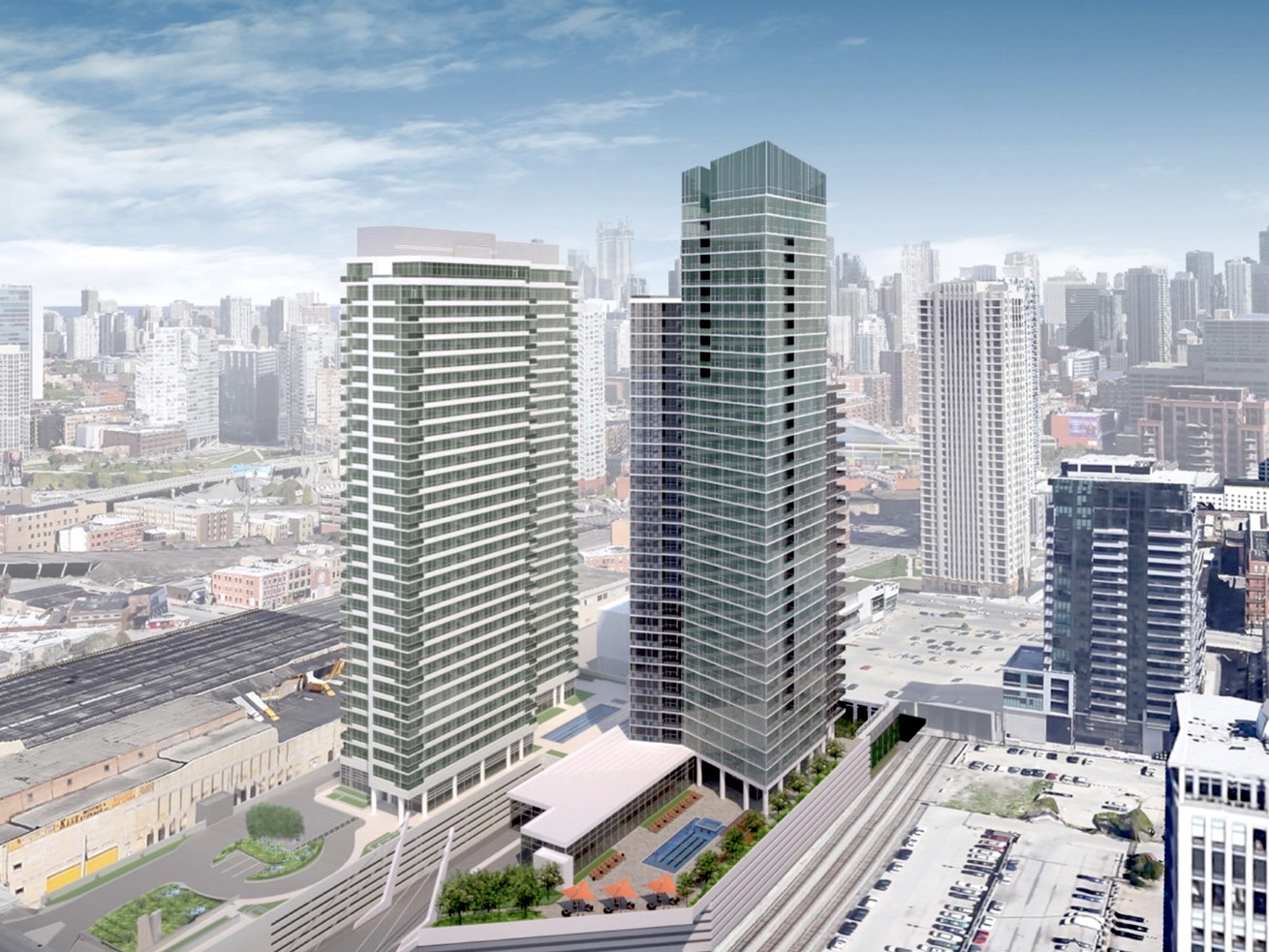 A rendering showing a glassy high-rise tower with an angled crown next to a shorter high-rise. The buildings stand next to train tracks and tall buildings stand in a row in the distance.